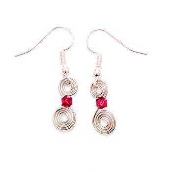 Cercei cu cristale swarovski rosii tip spirala